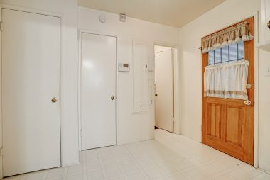 Separate indoor laundry room with pantry.