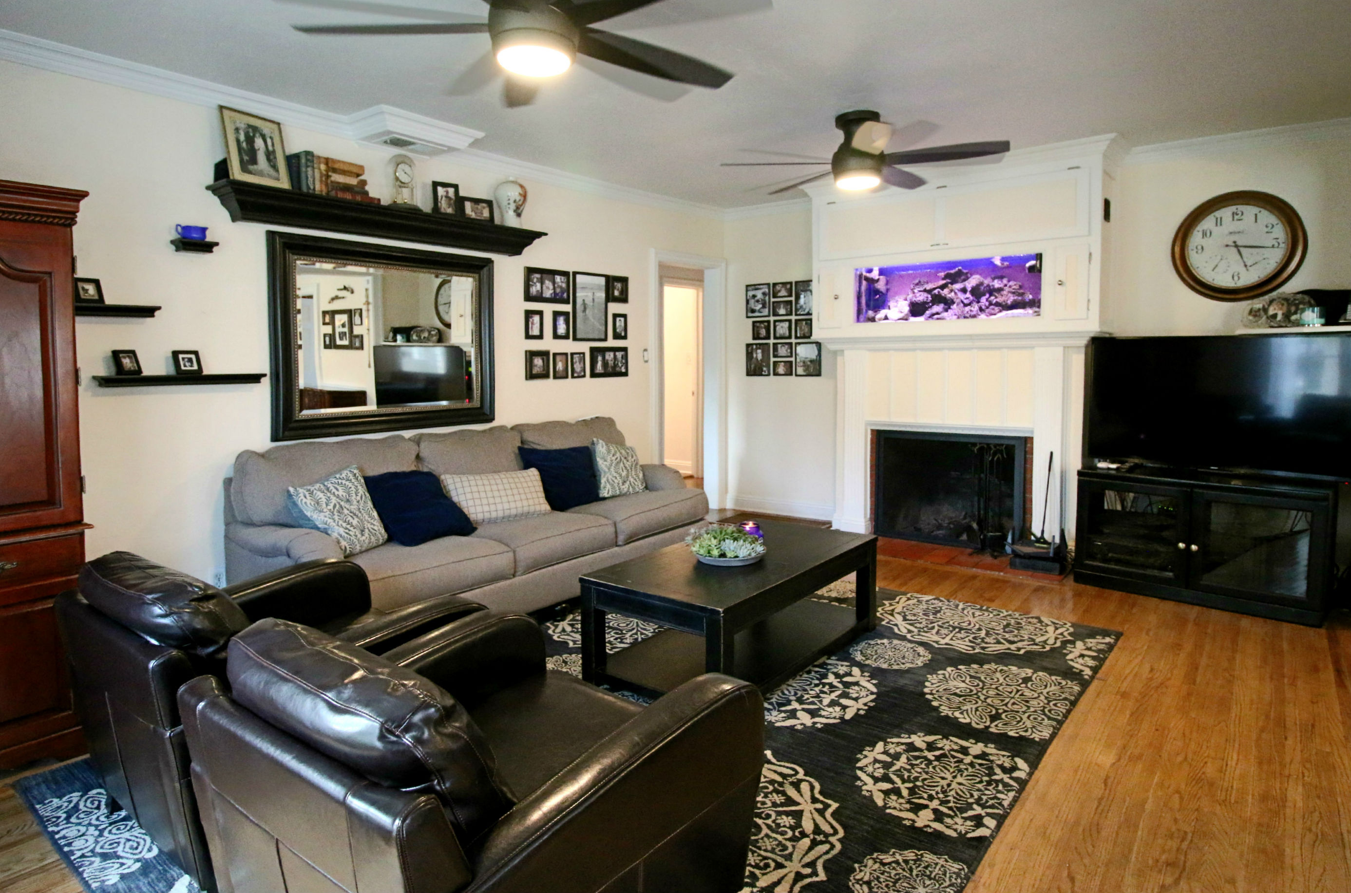 Refinished original hardwood floors throughout. Salt water fish tank above fireplace has been there 11 years and will stay with house if buyer wants it. If not, seller will remove and replace the fireplace mantel.