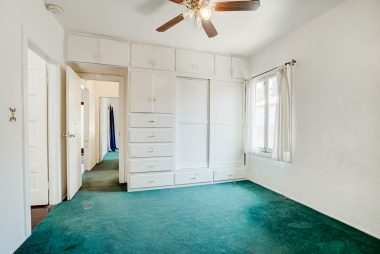 2nd bedroom with wall of amazing closet space.