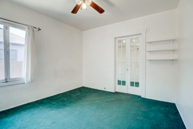 Alternate view of 2nd bedroom, with cute little French doors leading to bonus room at back of house.