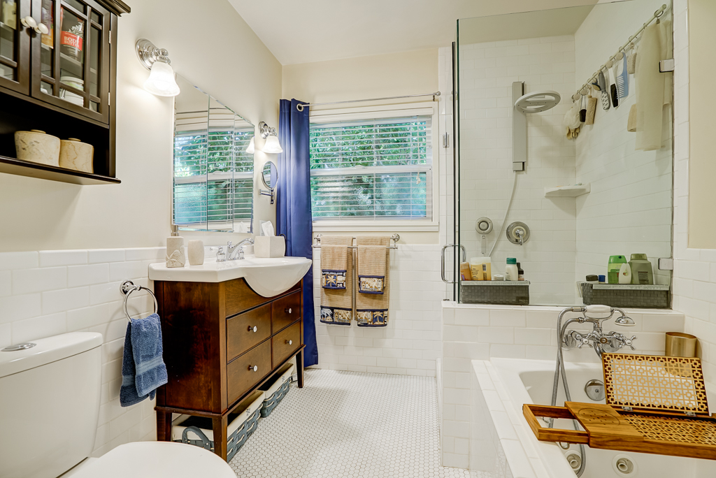 Remodeled bathroom with separate tub and shower.