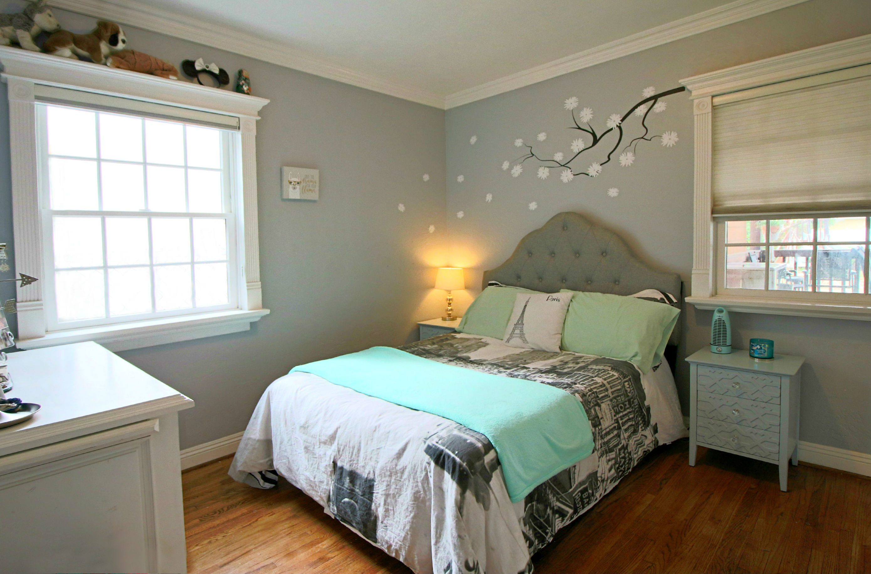 Second of three bedrooms with refinished original hardwood floors and double pane windows. Interior of home was painted with Benjamin Moore paint.