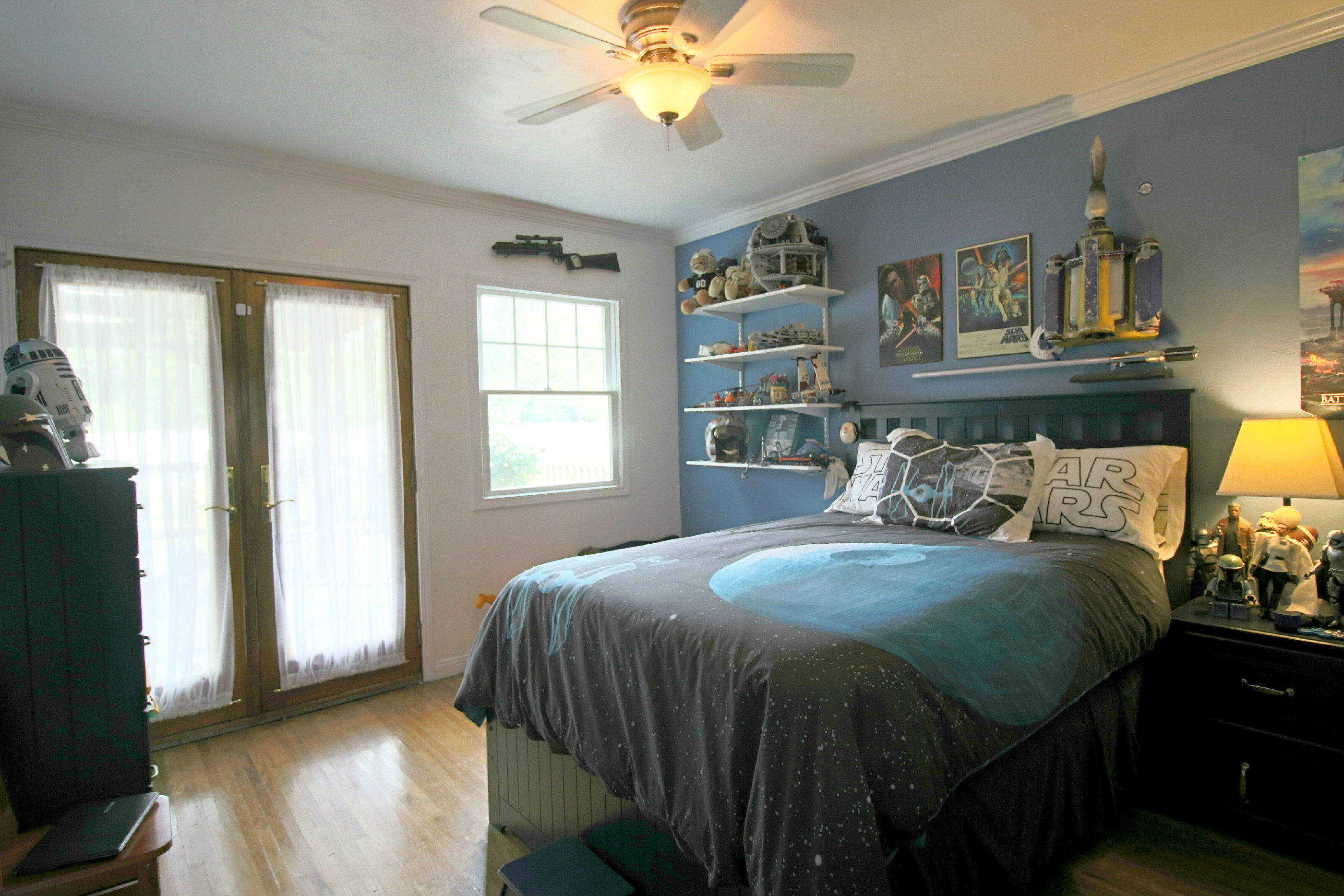 Third bedroom with refinished original hardwood floors and double French doors leading to the back deck.
