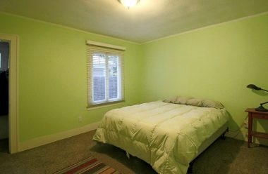 Large secondary bedroom with carpeting.