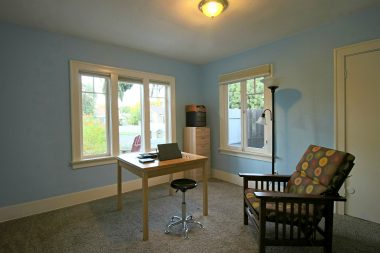Front bedroom with Hunter Douglas cordless blinds on the gorgeous original windows!