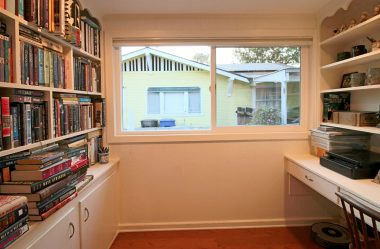 Built-in desk in this book nook is ideal for office or reading room.