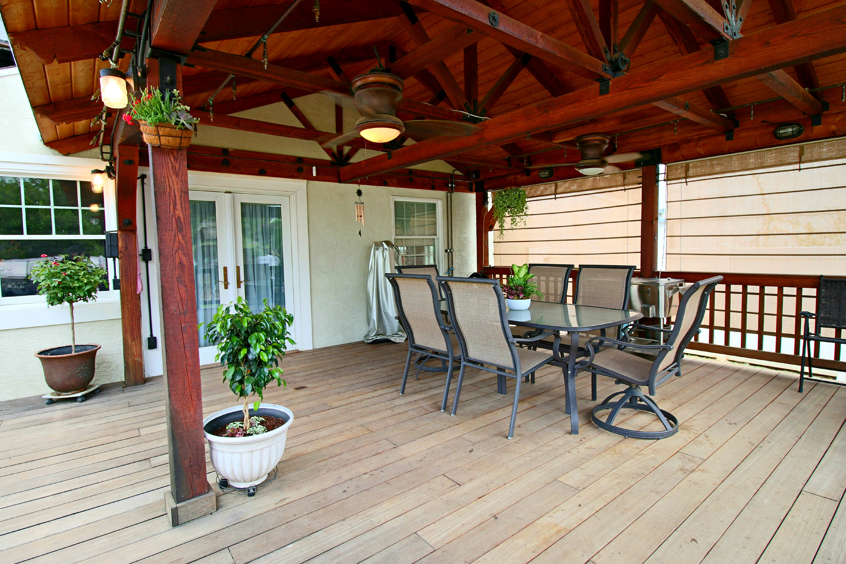 The structure above on Mangaris deck is made with Douglas fir, and the ceiling is tongue and groove Spruce. Copper pipe misters and lighting as well.