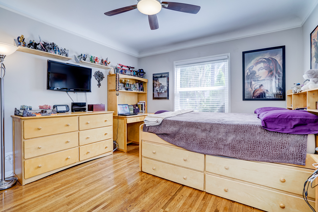 Front bedroom with gorgeous hardwood floors and new ceiling fan.