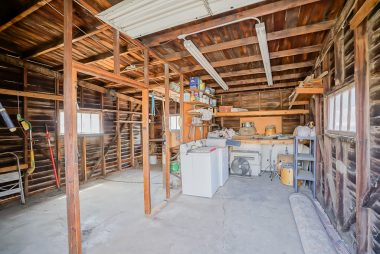 Garage interior with electricity -- great for storage. The carriage-style doors could accommodate a small car.