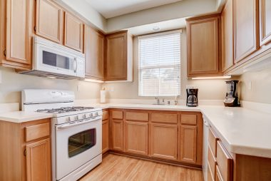 Gorgeous kitchen with stone counter tops with dishwasher and built-in microwave.
