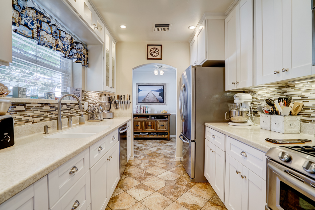 Spectacularly remodeled kitchen with Corian counter tops, stainless steel appliances, including dishwasher, built-in microwave, and soft-closing drawers.