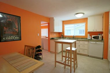 Alternate view of spacious kitchen with room for a preparation island and table/chairs.