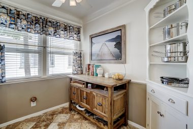 Breakfast nook with built-in corner hutch.