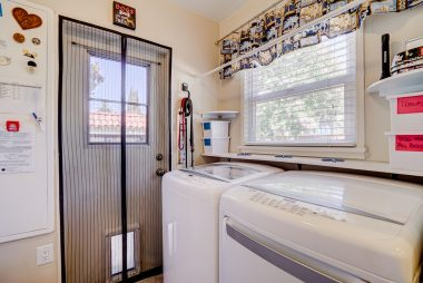 Indoor laundry room with $2,000 washer and gas dryer that remain with the house. In addition, there's a huge pantry as well, with a dry erase board inside a cabinet for keeping track of needed groceries!