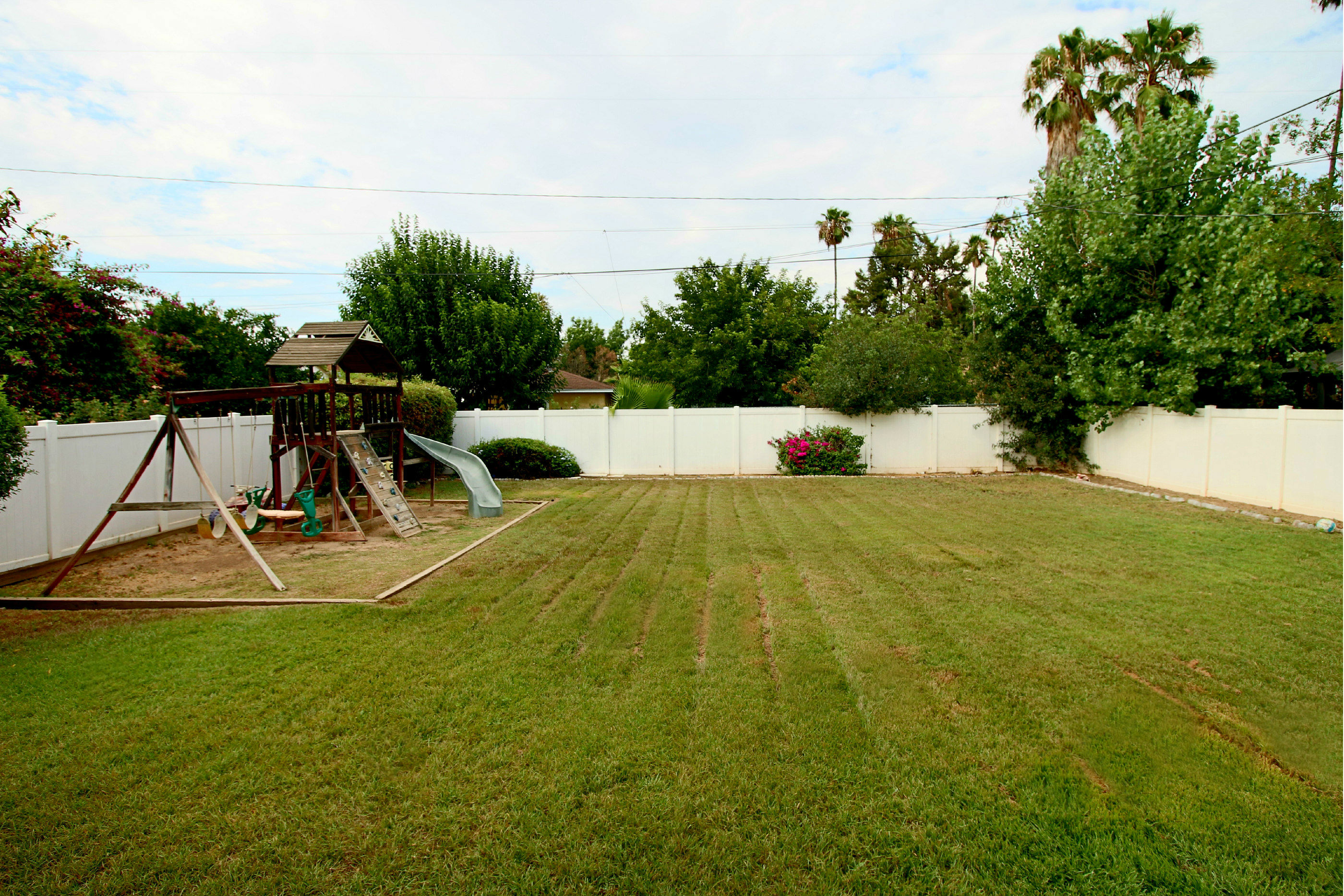 Amazing back yard for children and pets, completely surrounded by Fairway 20-year vinyl fencing (which is only 10 yrs old). Swingset will stay if buyers want it. Automatic sprinklers....AND best unobstructed view of Mt. Rubidoux fireworks -- invite all your friends over for the 4th of July!
