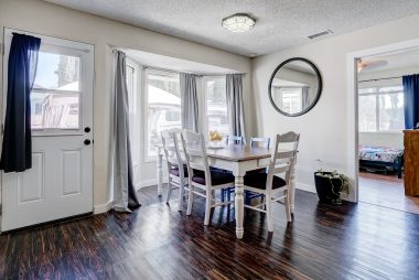 Formal dining room large enough for family gatherings any time of the year.