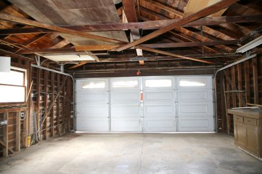 2-car garage with roll-up door.