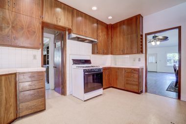 Alternate view of kitchen with view into living room.