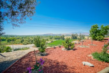 Tastefully landscaped throughout, with forever views!