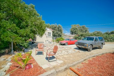 Another rental house on the property, with its own parking, gated garden/yard area, and amazing views!