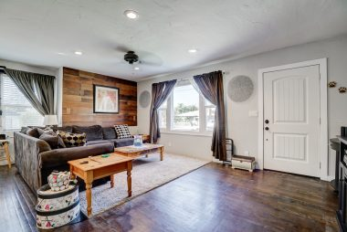 Living room with recessed lighting and original hardwood flooring and updated double pane windows throughout, as well as new doors.