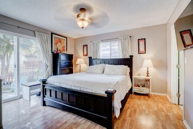 Master bedroom suite with ceiling fan, slider overlooking the huge backyard, two closets (one of which is a walk-in), as well as a private bathroom.