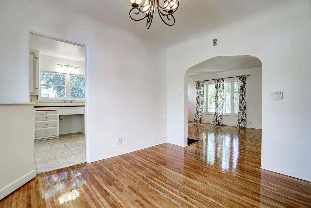 Formal dining room with views into the kitchen and the living room.