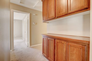 Hallway cabinetry leading to bedrooms.