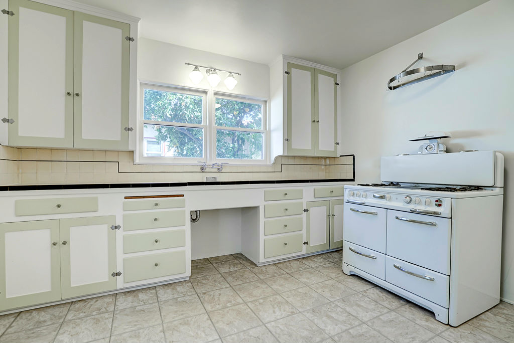 Adorable kitchen with antique gas stove and breakfast nook too.