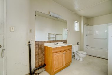 Master #2 bathroom with laundry hookups and separate entrance for guests or roommates.