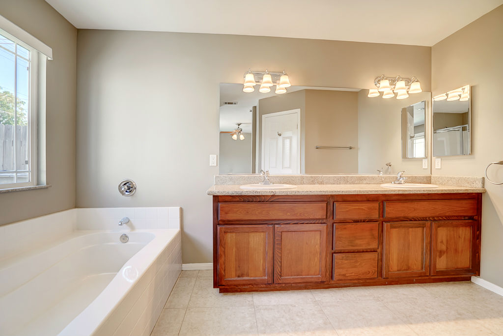 Master Bathroom With Double Vanity, Soaking Tub, And Separate Shower.