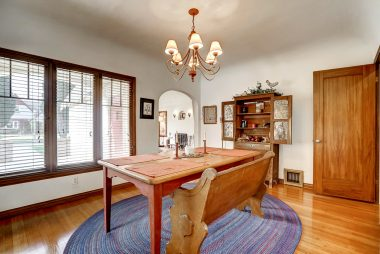 Formal dining room with coved ceiling and hidden trap door which leads to a small basement which would be ideal as a wine cellar, or extra storage.