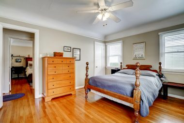 Each bedroom boasts a walk-in closet and refinished hardwood floors.