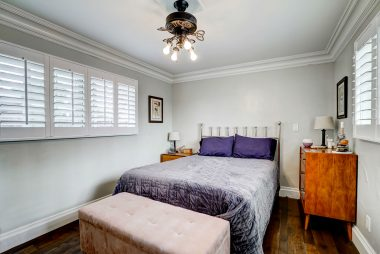 Large back bedroom with double pane windows, window shutters, and mirrored wardrobe doors (not pictured).