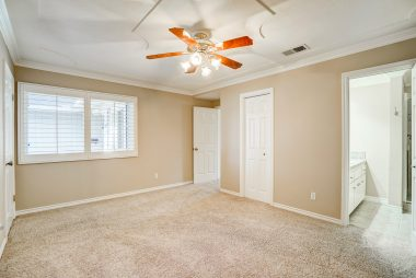 Master bedroom suite with two walk-in closets and a private remodeled 3/4 bathroom.