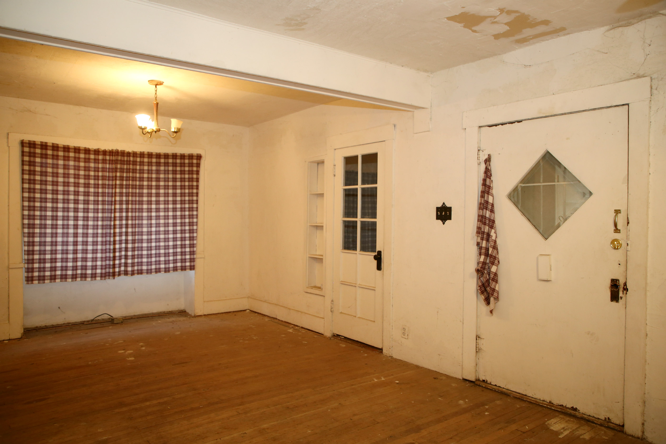 Dining area and door to bonus room which is an enclosed section of the front porch.