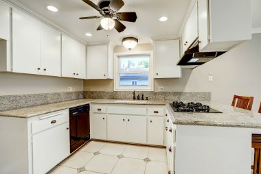 Bright kitchen with granite counter tops, gas range, dishwasher, ceiling fan, recessed lighting, and breakfast bar overlooking the spacious family room.