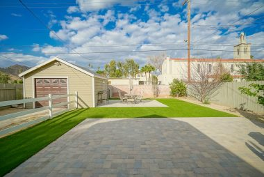Spacious yet low-maintenance backyard with artificial turf.