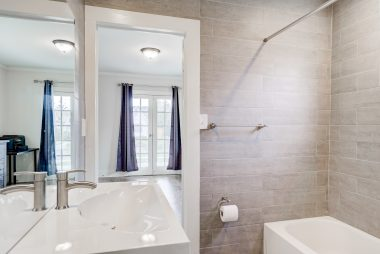Alternate view of remodeled full bathroom.
