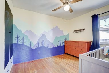 2nd bedroom with painted mural perfect as child's room.