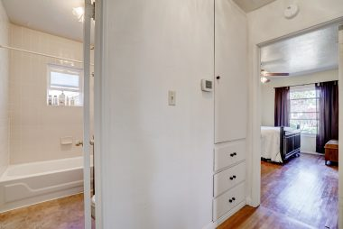 Hallway view into hall bath and master suite.