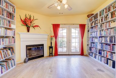 Library/office with fireplace and French doors leading to cute little outdoor sitting area.