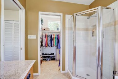Alternate view of master bathroom and the walk-in closet.