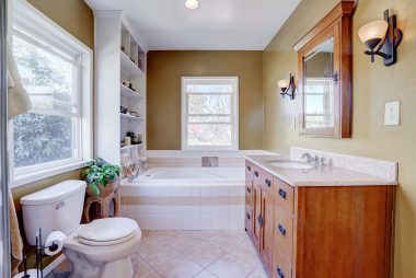 Master bathroom with shelving wired for TV so you can watch your favorite show while soaking in the jet tub.