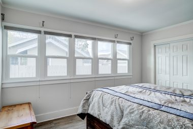 Middle bedroom with lots of natural light from double pane windows.