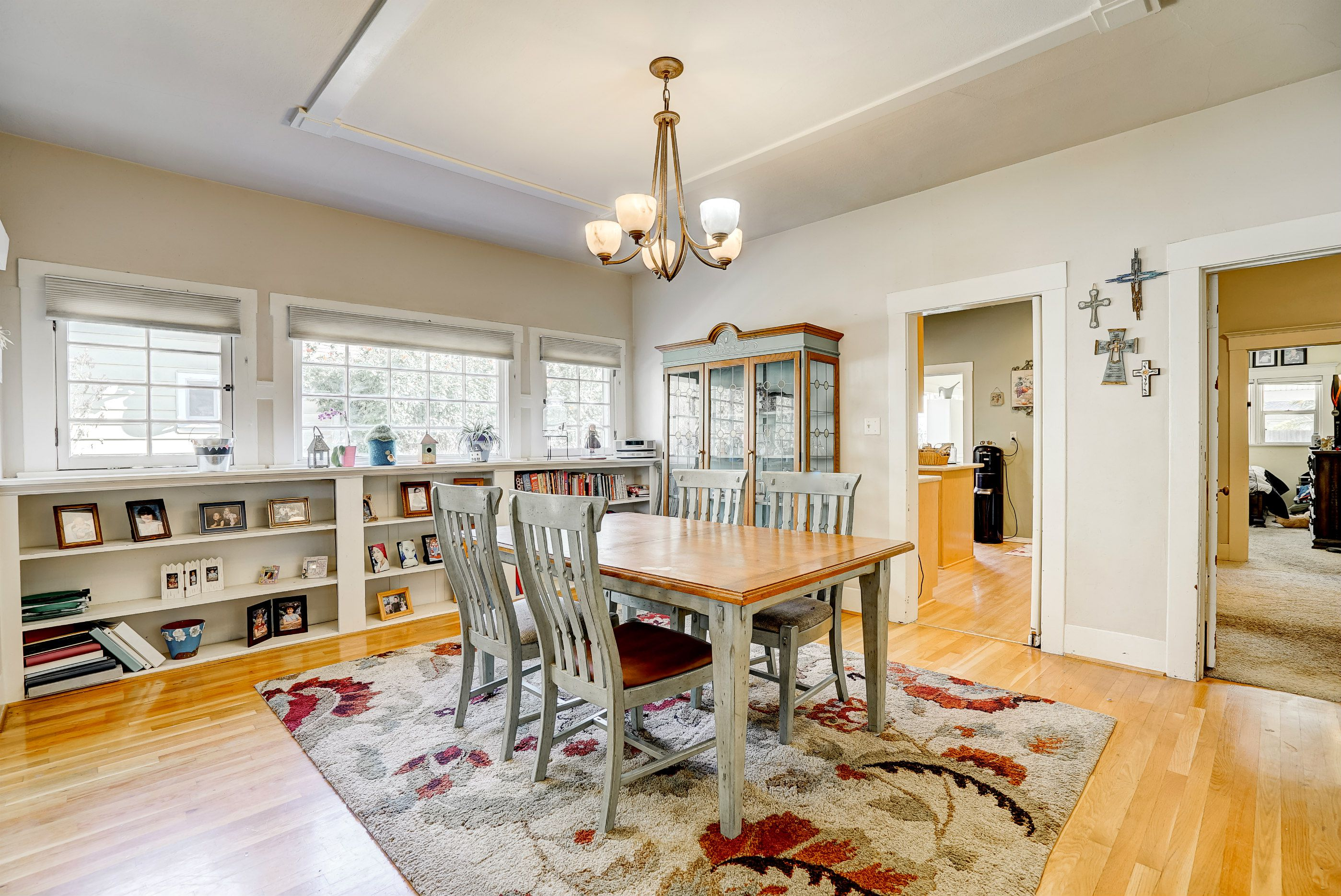 Large formal dining room with built-in bookshelves and original hutch on inside wall.