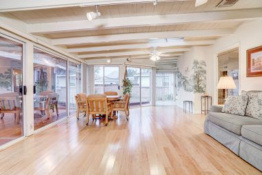 Expansive family room with track lighting, ceiling fans, sky light, and sliders to elegant back yard. In addition, this room is the perfect vantage point to watch the annual Mount Rubidoux fireworks!!