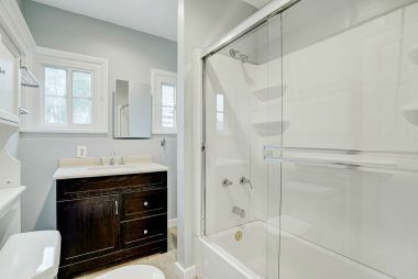 Remodeled hallway bathroom with brand new shower doors.