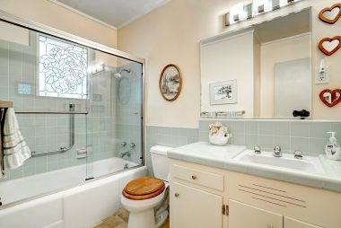 Hallway bathroom with vintage tile so pristine that you'd think it was installed yesterday, not 62 years ago!