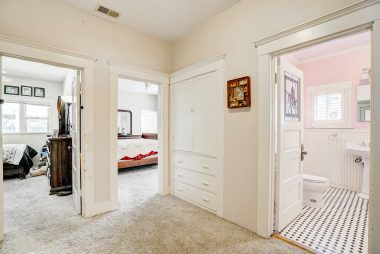 Exceptionally wide hallway leading to three of the bedrooms and the hallway bathroom.